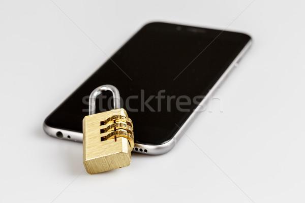 Mobiltelefon biztonság zár telefon fehér mobiltelefon Stock fotó © jarin13
