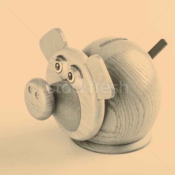 Piggy bank with money on white background Stock photo © jarin13