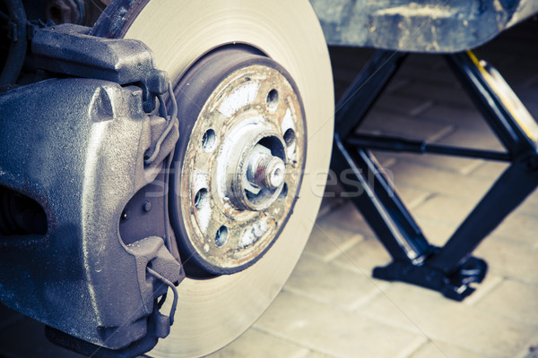 Stock photo: Repairing brakes on car