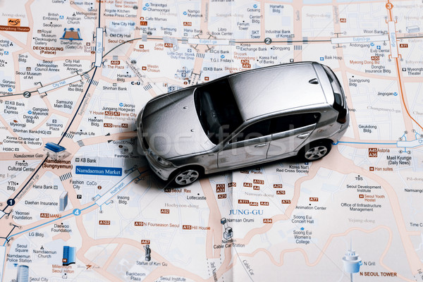 Stock photo: travel concept - small car on Seoul city map