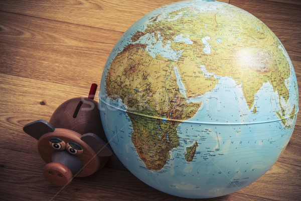 Money box with globe of world Stock photo © jarin13