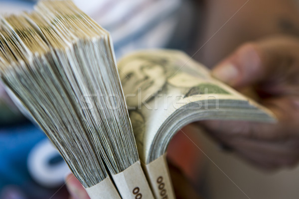 pack of money - big pile of banknotes in hand Stock photo © jarin13