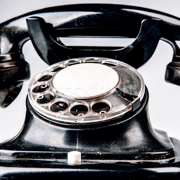 Vieux noir téléphone poussière blanche isolé Photo stock © jarin13