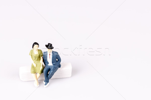 toy models of old couple sitting on chalk sofa Stock photo © jarin13