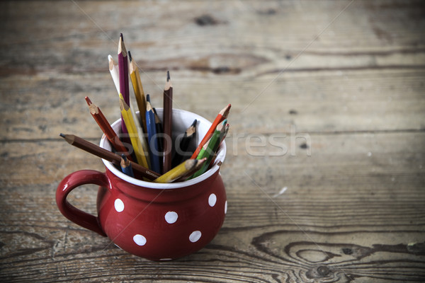 Stock photo: vintage crayons in the red cup