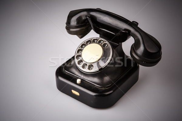 Velho preto telefone poeira branco isolado Foto stock © jarin13