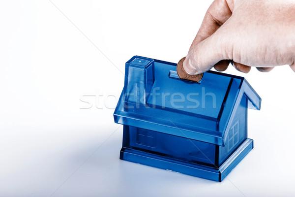 Kék ház pénz doboz férfi kéz Stock fotó © jarin13