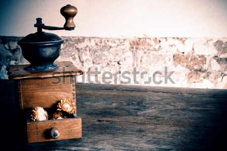 Vintage wooden coffee mill grinder with yellow flowers in open drawer Stock photo © jarin13