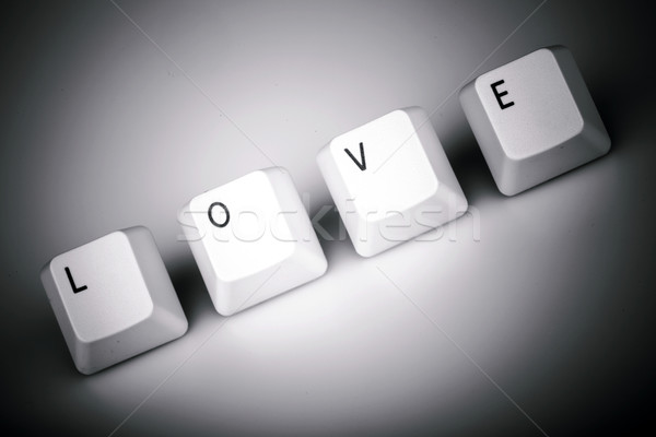text love formed with computer keyboard keys on white background Stock photo © jarin13