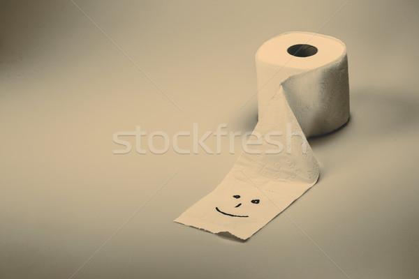 Carta igienica rotolare sorriso bianco stanza bagno Foto d'archivio © jarin13