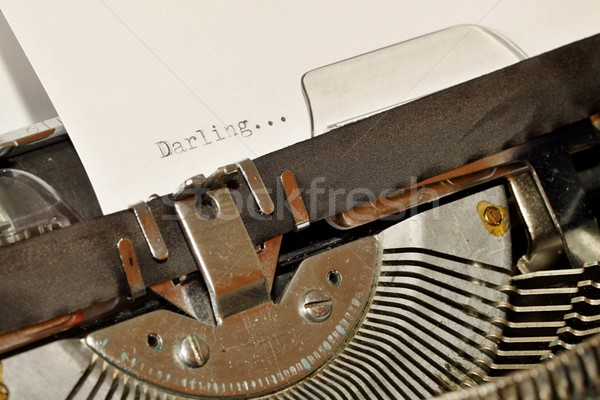 Stock photo: Darling word typed on old black typwriter