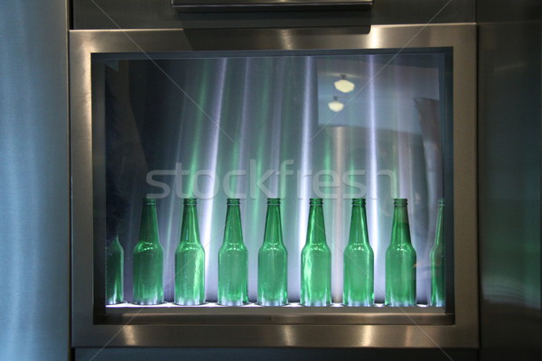 empty beer bottles in silver frame Stock photo © jarin13