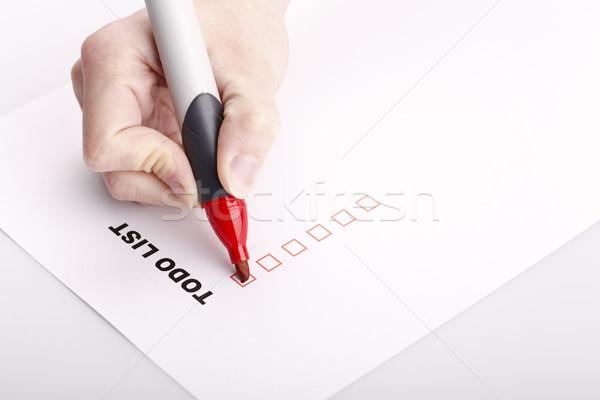 リストを行うには 女性 手 マーカー チェック 孤立した ストックフォト © jarin13