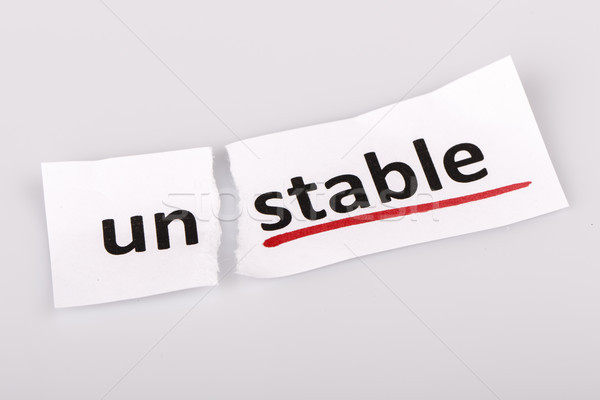 The word unstable changed to stable on torn paper Stock photo © jarin13