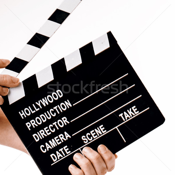 Movie flapper in woman´s hands on white background Stock photo © jarin13