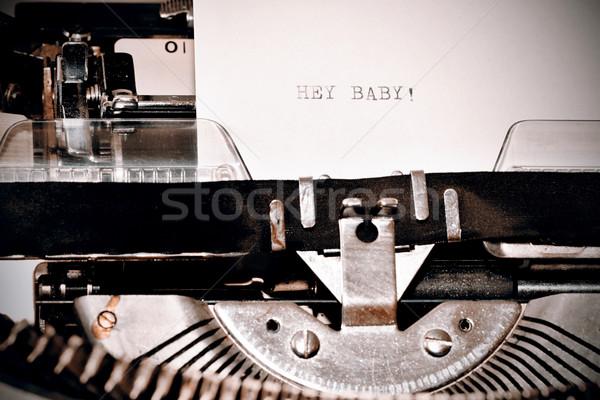 Text Hey Baby typed on old typewriter Stock photo © jarin13