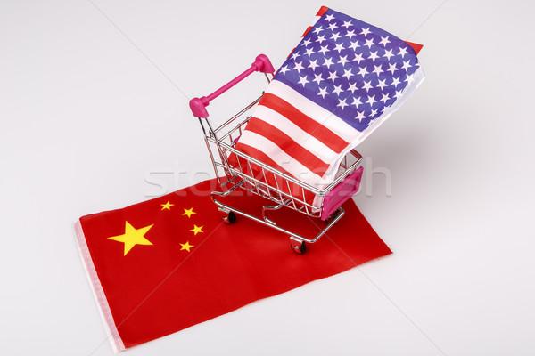 Shopping cart with USA flag on China flag Stock photo © jarin13