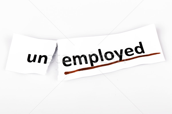 The word unemployed changed to employed on torn paper Stock photo © jarin13