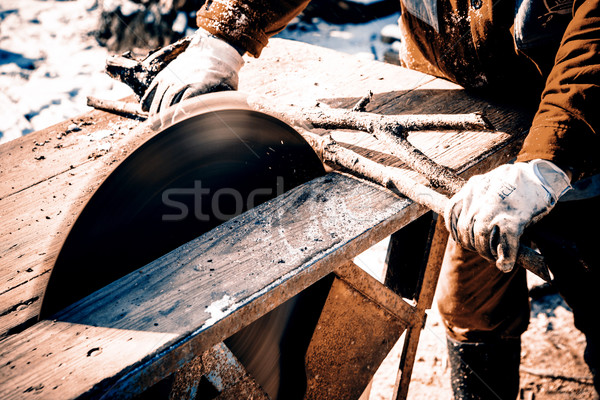 Stock photo: Man working with circular saw blade
