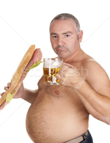 man eating and drinking Stock photo © jarp17