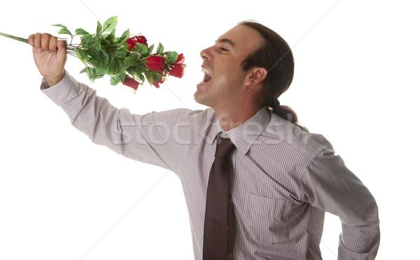 Dal szeretet férfi virágok kéz mosoly Stock fotó © jarp17