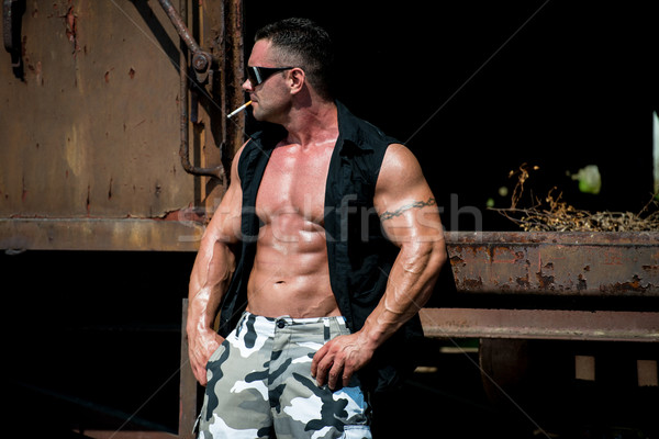 Bodybuilder Smoking A Cigar Stock photo © Jasminko