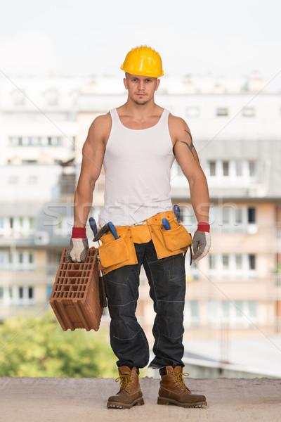 Jonge knap bouwer baksteen werknemer versnelling Stockfoto © Jasminko