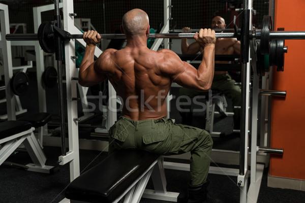 Sağlıklı olgun adam egzersiz omuz spor salonu karanlık Stok fotoğraf © Jasminko