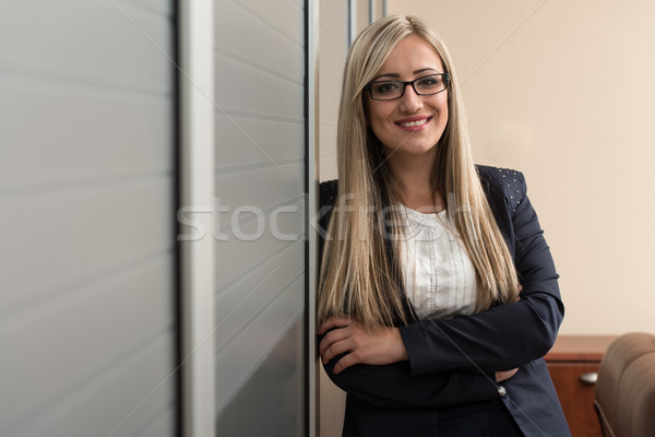 Young Businesswoman Relaxes Standing In The Office Stock photo © Jasminko