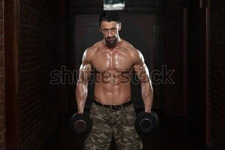 Masculino musculação pesado peso exercer Foto stock © Jasminko