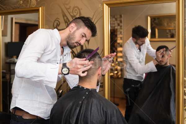 Hairdresser Making Haircut To Young Man Stock photo © Jasminko