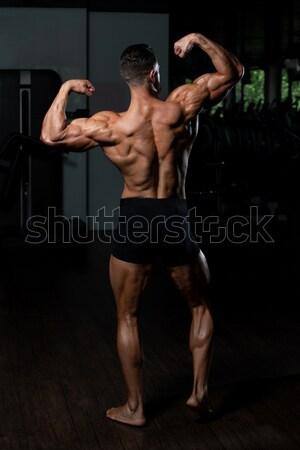Muscular Men Flexing Muscles On Black Background Stock Photo C Jasminko Ibrakovic Jasminko 7811605 Stockfresh