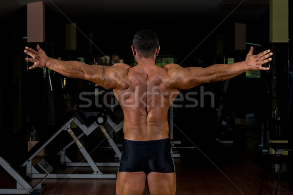 male body builder showing his arms Stock photo © Jasminko