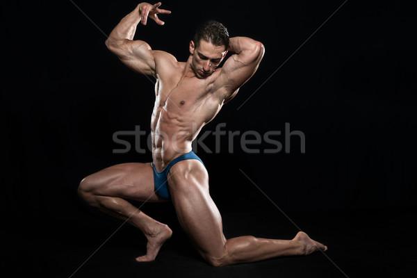 Genç vücut geliştirmeci kaslar siyah bo Stok fotoğraf © Jasminko