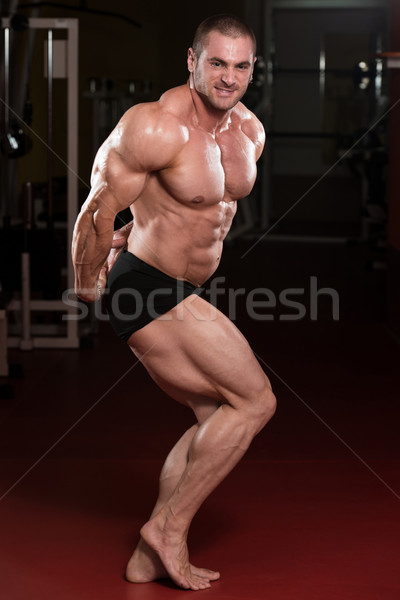Muscular Man Flexing Muscles Stock photo © Jasminko