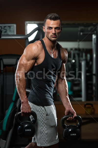 Athletic Man Workout With Kettle Bell Stock photo © Jasminko