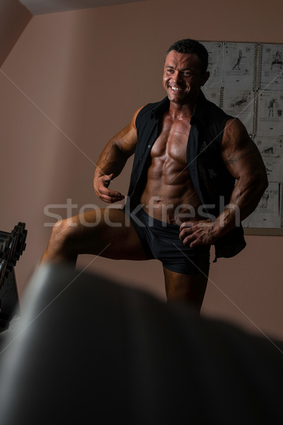 Homme bodybuilder souriant noir shirt sourire Photo stock © Jasminko
