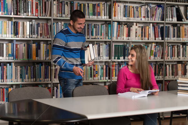 Handsome Male Student Asking  For Studying Together Stock photo © Jasminko