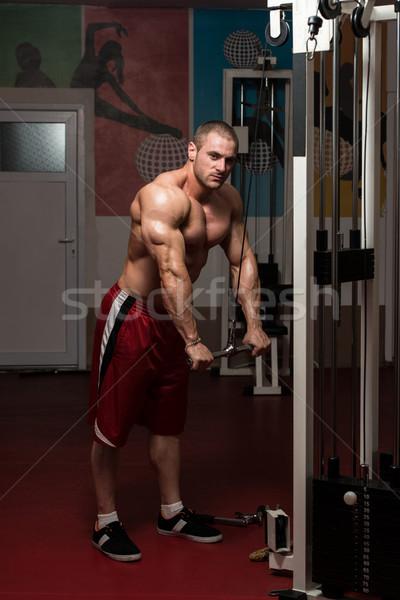 Zdrowych młody człowiek wykonywania triceps młodych kulturysta Zdjęcia stock © Jasminko
