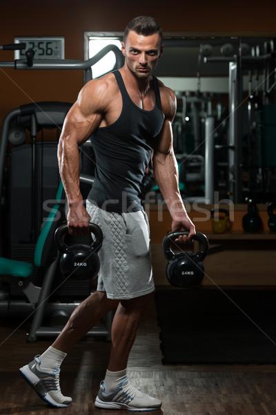Férfi bogrács harang izmos testmozgás modell Stock fotó © Jasminko