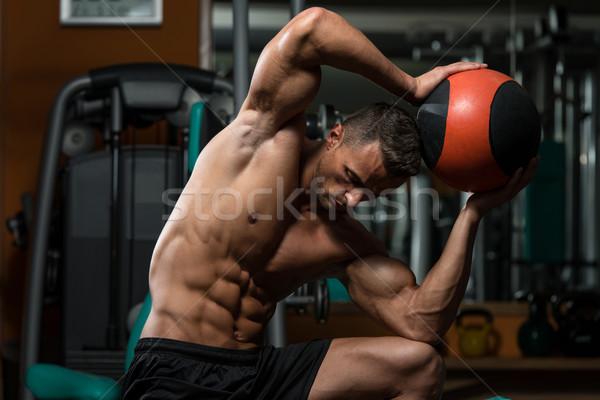 Muscular Man Exercise With Medical Ball Stock photo © Jasminko