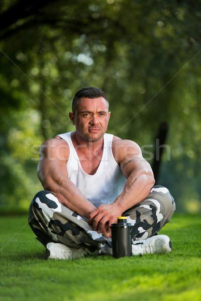 Bodybuilder Resting In Nature Stock photo © Jasminko