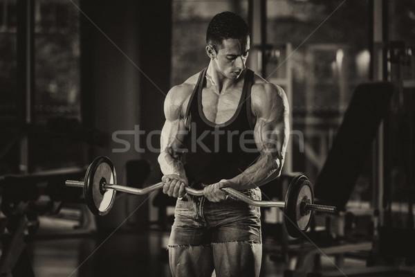 Muscular Man Exercising Biceps Stock photo © Jasminko