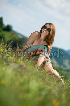 young woman in dress sitting on the grass Stock photo © Jasminko