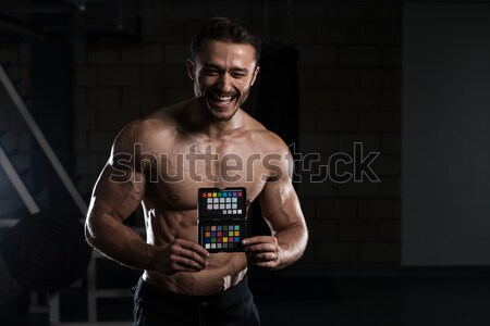 Bodybuilder Resting After Crossfit training Stock photo © Jasminko