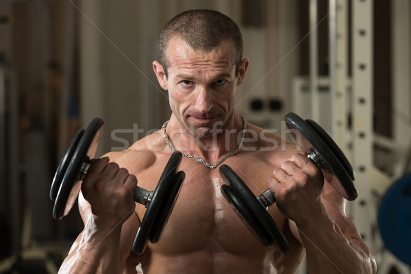 Bodybuilder Working Out Biceps In A Health Club Stock photo © Jasminko