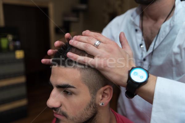 Kezek profi haj stylist fodrász fiatalember Stock fotó © Jasminko