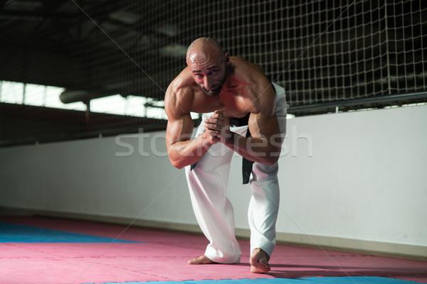 Martial Arts Man In Kimono Exercising Karate Stock photo © Jasminko