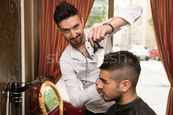 Hairdresser Cleaning Young Man After Haircut Stock photo © Jasminko