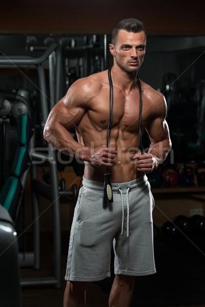Bonito muscular homem saltando corda cardio Foto stock © Jasminko